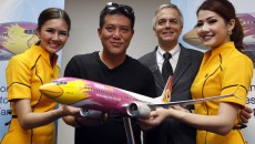 Thai budget airlines Nok Air's Chief Executive Officer Patee Sarasin poses with Boeing's Senior Vice President of Global Sales of Commercial Airplanes John Wojick after an announcement of new orders at the Singapore Airshow